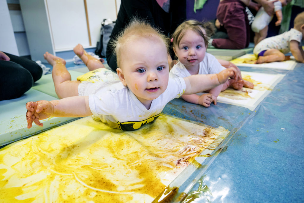 Babies at colour immersion at the children's cultural centre.
